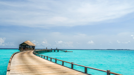 ponton: view of water bungalow in irufushi island,  maldives Editorial