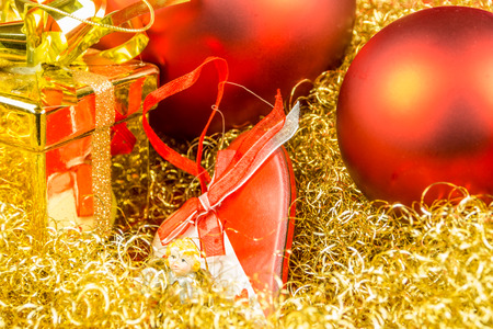 gloden: Christmas gift, heart and balls on gloden background Stock Photo