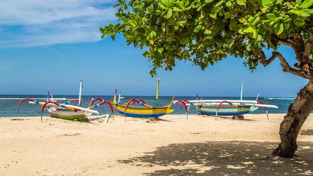 sanur: beach in bali, three boats ready to sail, sanur