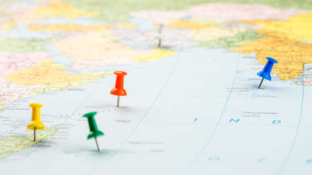 multiple targets: draw-pin stick into real map, identification of final destination, holiday in Indian Ocean Stock Photo