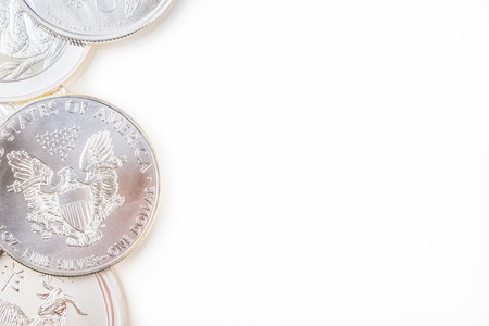 silver coins: silver coins on white background
