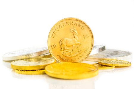 an ounce: golden krugerrand standing on edge