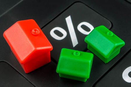mortgage rates: calculator and miniature houses business background