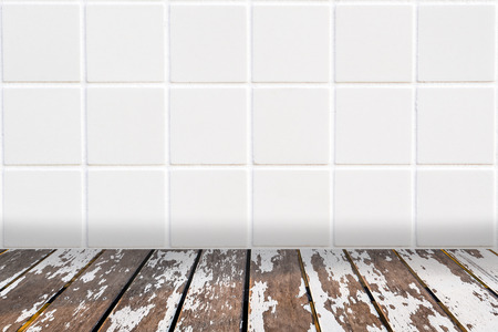 laths: wall made of little modern beige ceramic mosaic and floor made of uncared wooden laths