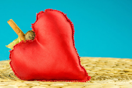 turquise: red heart decoration on turquise color background