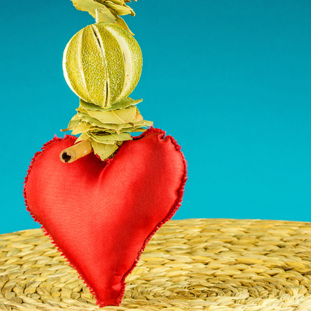 turquise: red heart decoration on background made of dry banana leaf with circle texture and turquise color