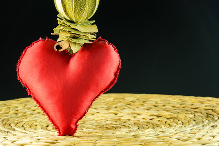 red heart decoration on background made of dry banana leaf with circle texture and black color