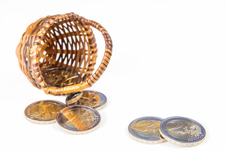 inflation basket: two euro coins in wicker basket on white background