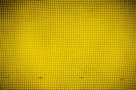 vignetting: closeup of yellow mesh with vignetting in rectangular form