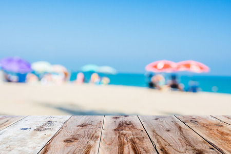an atmosphere: wooden floor and blurred beach atmosphere as background