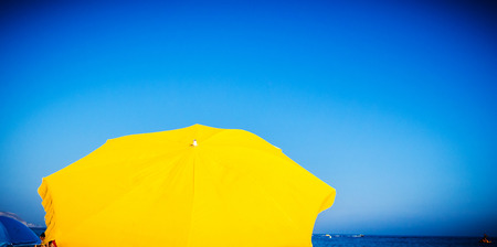 vignetting: umbrellas with blue sky as a background with vignetting Stock Photo