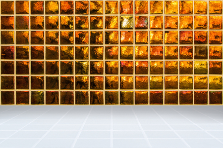 mosaic floor: architectual background made of golden mosaic wall and white mosaic floor
