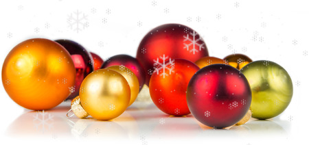 fragile peace: multicolored christmas balls on white background with snowflakes everywhere