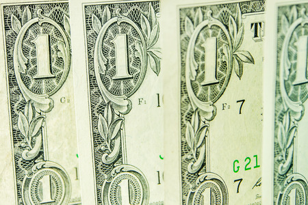 four in one: four one dollar banknotes standing one after another Stock Photo