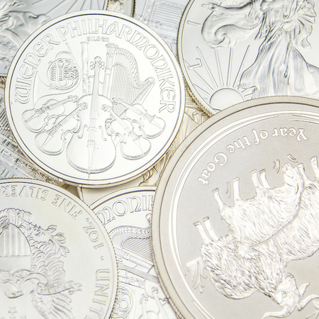 ounce: stack of various one ounce silver coins Stock Photo