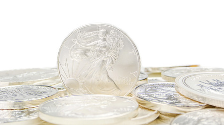 ounce: one ounce of silver eagle standing on edge on other silver coins