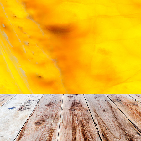 lath in modern: orange onyx background and wooden floor in the front as a surface Stock Photo