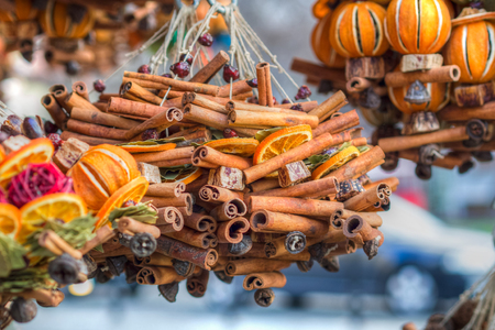 savour: combination of colors and fragrances on christmas market in an european city, very strong cinnamon fragrance