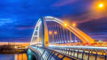 infrastructure: Apollo bridge in Bratislava, Slovakia with nice sunset and right part of river Danube Stock Photo