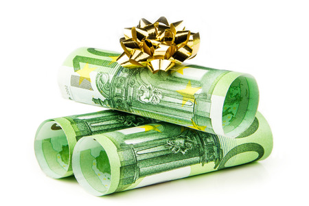 one hundred euro banknote: three pieces of one hundred euro banknote rolls with golden knot on white background Stock Photo