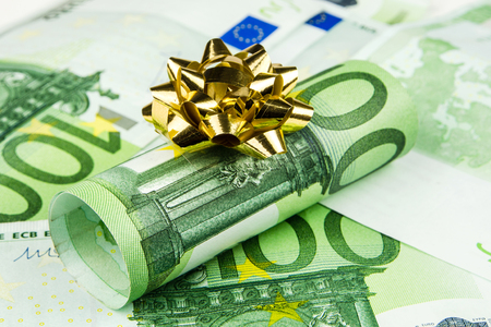 one hundred euro banknote: one piece of one hundred euro banknote roll with golden knot on euro banknotes background