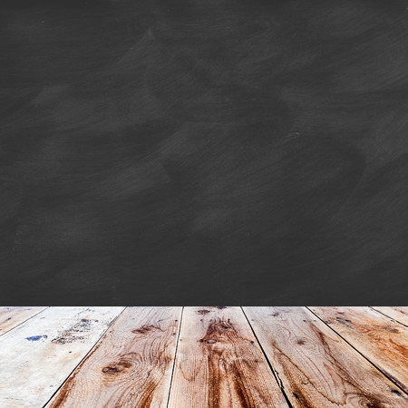 lath in modern: brown wooden floor and black chalk board blank and smudged in square form Stock Photo