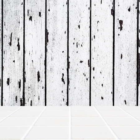 mosaic floor: white ceramic mosaic floor and white wooden wall in square format Stock Photo