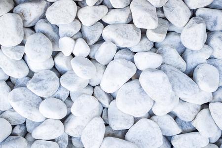 white pebble: closeup of sidewalk made of many little round white pebble stones