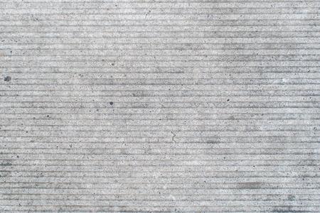 lineas horizontales: closeup view of grey  facade concrete with horizontal lines