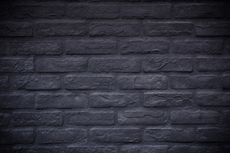 vignetting: black rectangle brick mosaic in rectangle form with many irregularities, vignetting, black brick background
