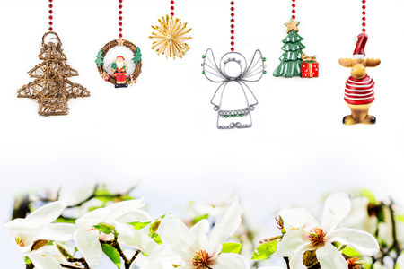 christmas decorations hanging on red chain with magnolia theme on white background stock photo 65570883 - Christmas Chain Decorations