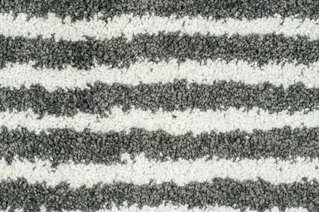 beige: closeup of carpet with black and white horizontal pattern Stock Photo