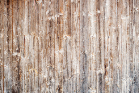 closeup of an brown wooden textured background with many scratches and worn varnish