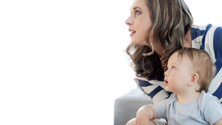 closeup of mother and  her boy child gazing upwards to the white background, to the future Banco de Imagens