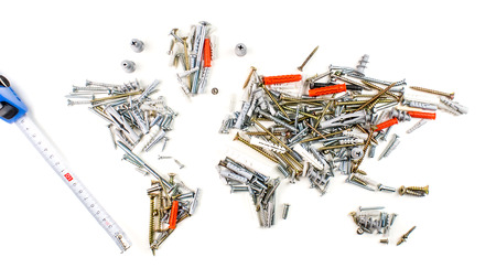 map of the world made of screws, fasteners and other mechanical tools with measuring tape on white background, worldwide construction industry concept
