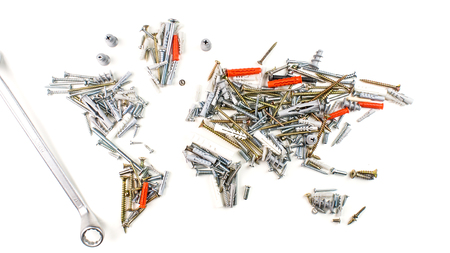map of the world made of screws, fasteners and other mechanical tools with screwdriver on white background, worldwide construction industry concept Stock Photo