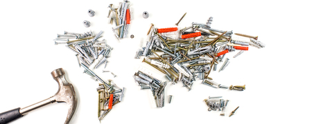 map of the world made of screws and fasteners with hammer on white background, worldwide construction industry concept
