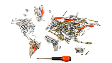map of the world made of screws, fasteners and other mechanical tools with screwdriver on white, worldwide construction industry concept Stock Photo