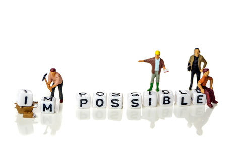 personal development and career growth or make possible concept in order to achieve set goals, white background with miniature figurines watching at it