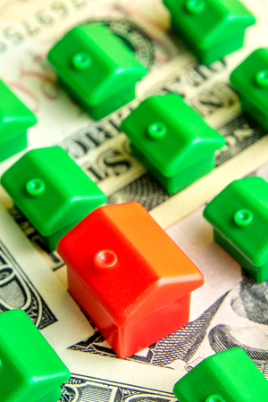 how to choose the perfect house for everyone, green little houses in row on dollar banknotes with one red house selected