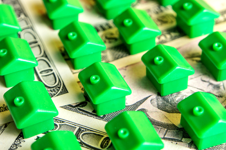 how to choose the perfect house for everyone, green little houses in row on dollar banknotes