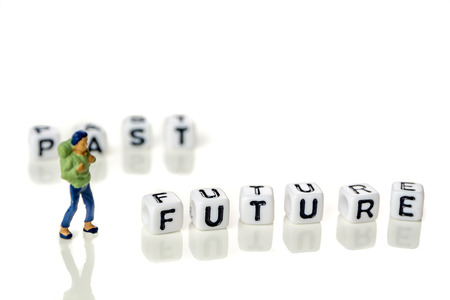personal development and career growth or leting the past and be heading to the future concept in order to achieve set goals, grey background with miniature figurines watching at it Stock Photo - 109105151