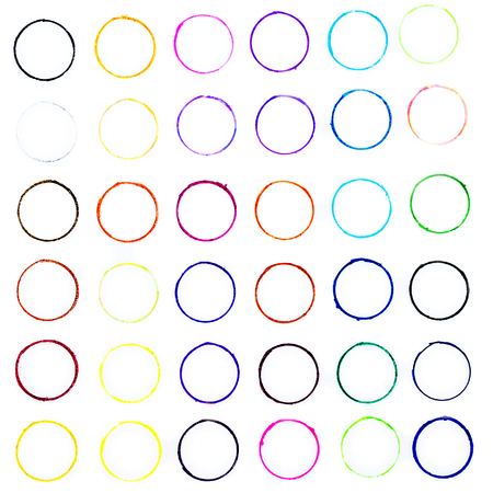 closeup of many little hand drawn multicolored circles illustration with stains and blots on white background, usage in graphic design and other creative decorations Stock Photo
