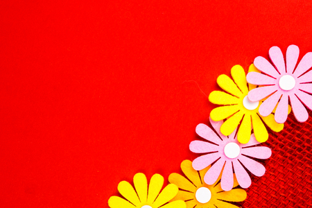 gift card with red background and ribbon band with many multicolored flowers and plenty copy space for the text