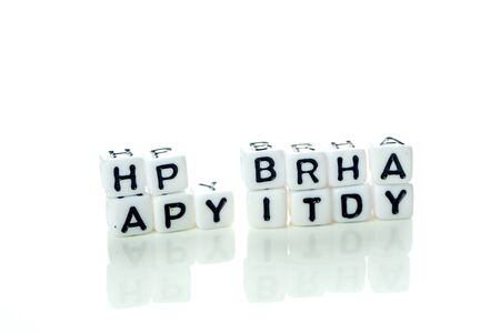 happy birthday special unconventional card made of white cubes with black letters and birthday decorations on white background