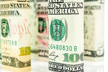 american dollar banknote blocks in all denominations in one row on white background 写真素材