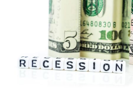 recession concept, american dollar banknote blocks in all denominations in one row on white background with the word recession made of little white cubes
