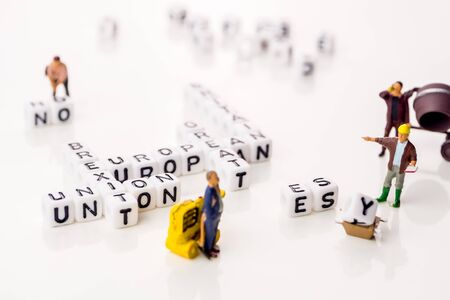 little white dices with black letters forming a crossword with the theme brexit, Great Britain exting European Union on white background Imagens