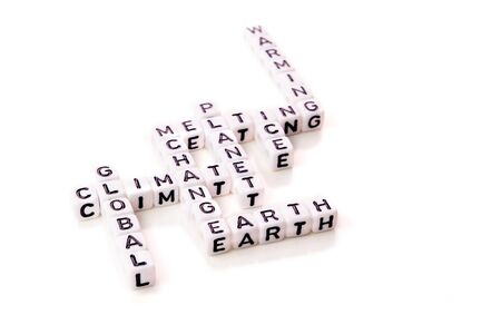 global climate change with planet warming and ice melting words in shape of white cubes with black letters on white background