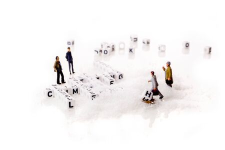 global climate change with planet warming and ice melting words in shape of white cubes with miniature workers figurines with black letters on white snowy background